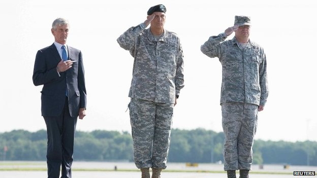 The Honorable John M. McHugh, Secretary of the United States Army, General Raymond T. Odierno, Chief of Staff, U.S. Army and Col Richard G. Moore, Commander, 436th Airlift Wing, (L-R) attend the dignified transfer of the remains of Major General Harold Greene at the Dover Air Force Base in Dover, Delaware, 7 August 2014