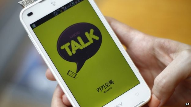 File photo: A woman opens KakaoTalk, a South Korean mobile messaging app, 20 August 2012