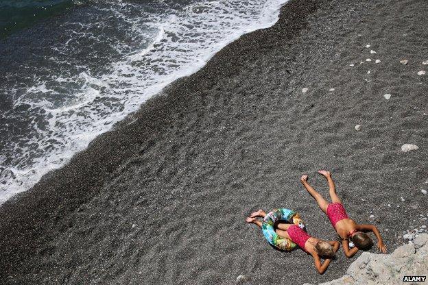 Girls on beach in Crimea, 2014