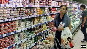 A woman holds dairy products in a supermarket in Moscow