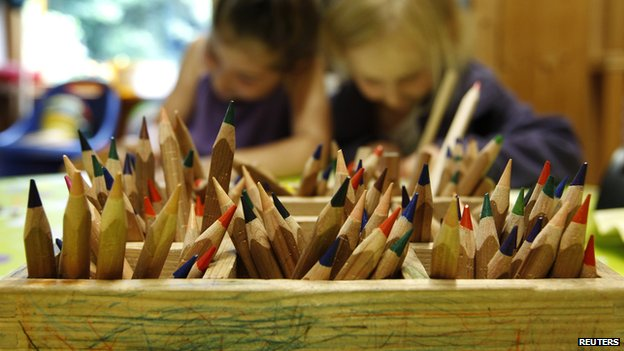 Colour pencils pictured as children draw