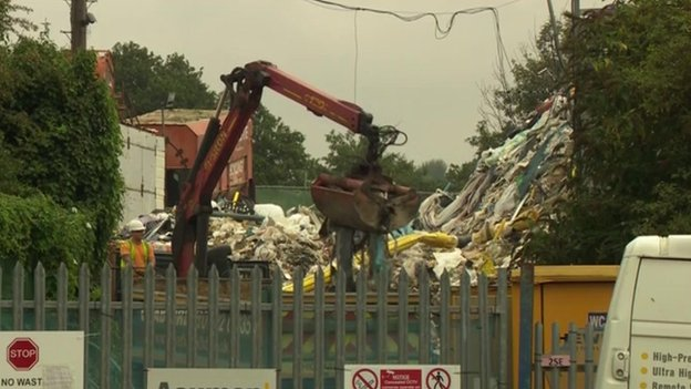 Rubbish being removed from the giant pile in Orpington