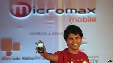 Model holding up micromax phone