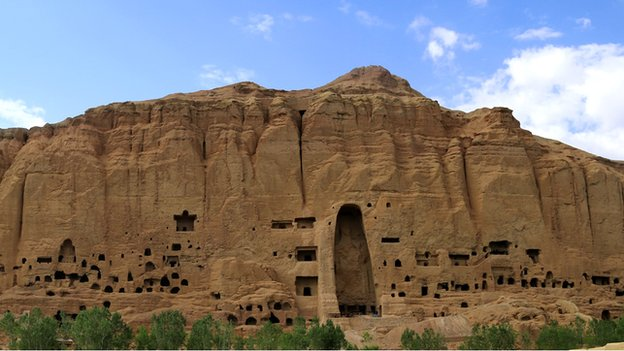 The niche once occupied by the 38 and 55 metre high buddha statues dominates the Bamiyan cliffs