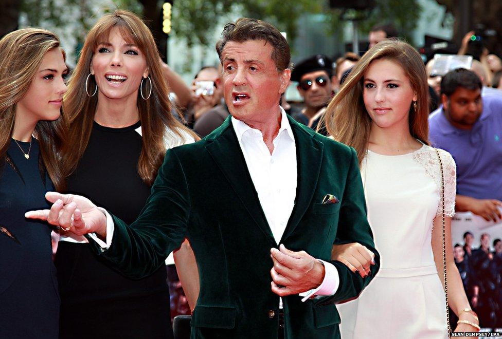 US actor Sylvester Stallone, his wife Jennifer Flavin (second from left) and their daughters Sistine (left) and Sophia arrive for the world premiere of his latest film The Expendables 3 at the Odeon Leicester Square in London