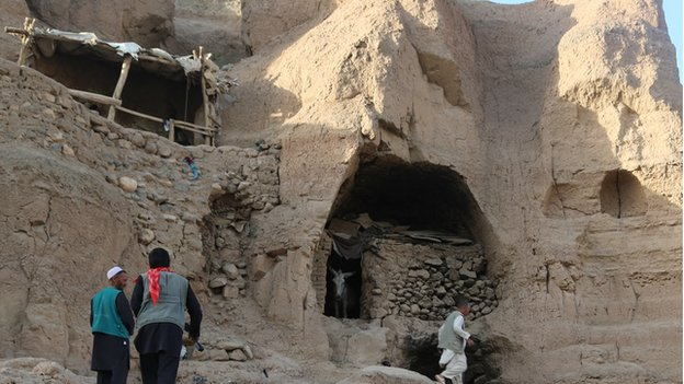 Many of the ancient caves have been modified with wood and mud brick constructions