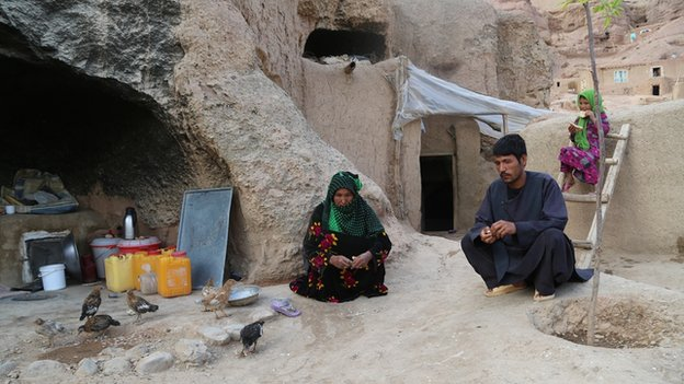 Halima and her family keep live stock at their cave dwelling to help them survive