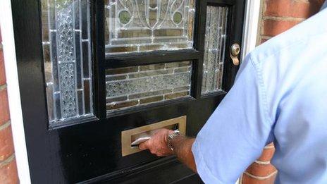 Postman delivering letters