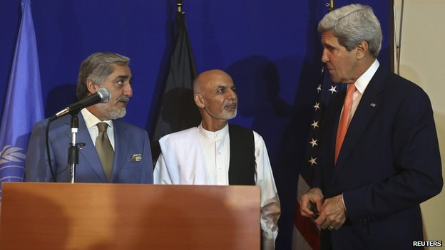 US Secretary of State John Kerry (right) speaks to Afghan presidential candidates Ashraf Ghani and Abdullah Abdullah (left)