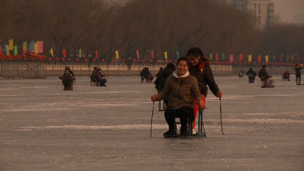 Two people on a frozen lake