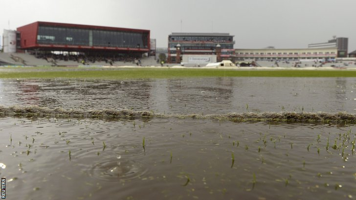 Rain soaks the boundary at Old Trafford