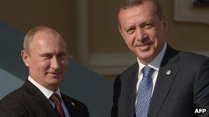 Mr Putin (left) meeting Mr Erdogan in St Petersburg last year