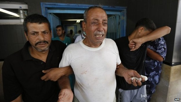 Palestinian man mourns after his son is killed in an Israeli air strike in Gaza City on 8 August 2014