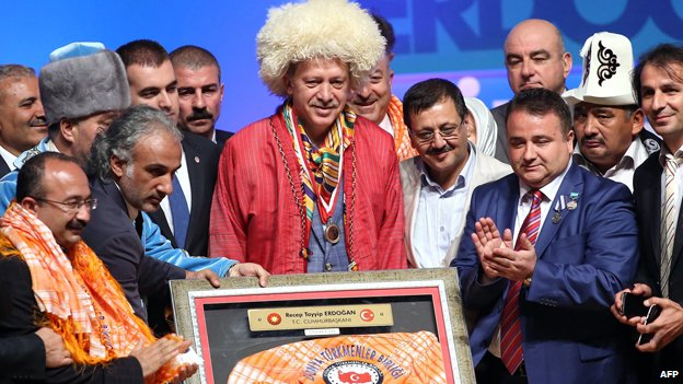 Mr Erdogan dons traditional Turkmen garb during a meeting of the ruling AKP party in Ankara