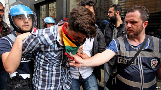 A protester is arrested in Istanbul in May 2014