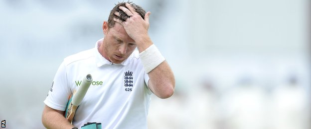 England's Ian Bell walks off