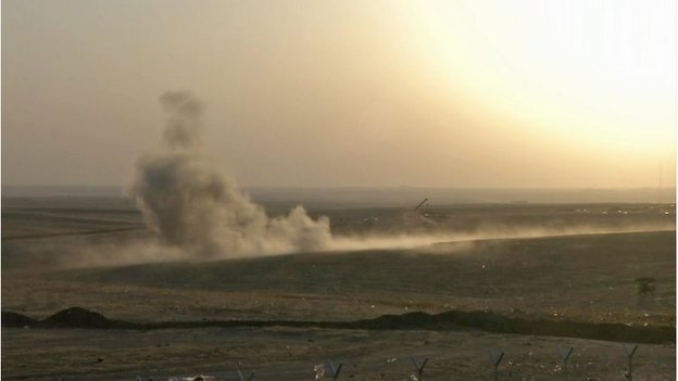 Smoke rising from airstrikes targeting Islamic State militants near the Khazer checkpoint outside of the city of Irbil in northern Iraq, Friday, Aug. 8, 2014.