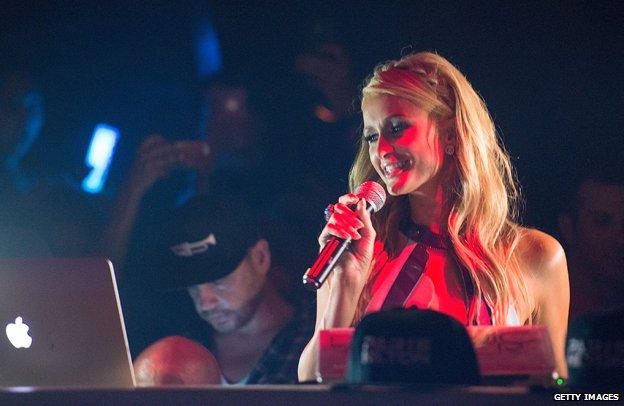 Paris Hilton holding microphone