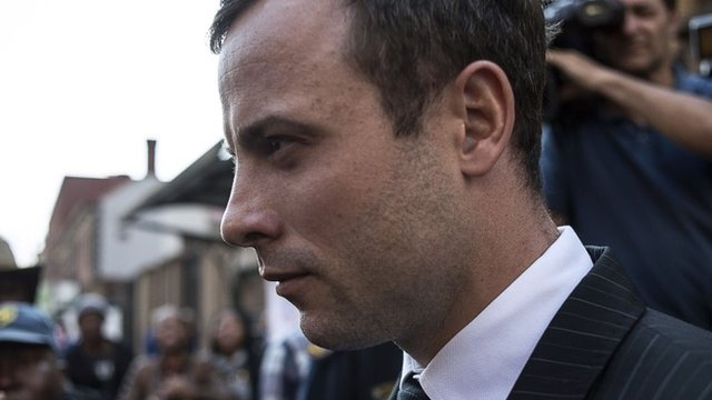 South African Paralympian athlete Oscar Pistorius leaves the High Court in Pretoria on 8 August 2014