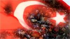 Turkish flag over crowd