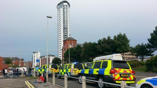Police vehicles outside the Meridian Tower