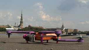 Air Dog drone on the ground with Riga in the background