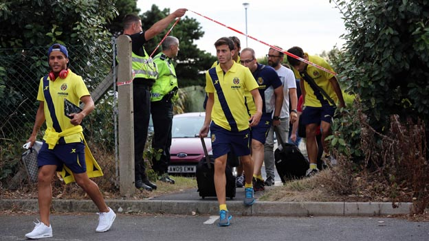 Villarreal players take an alternative entrance to the Marriott hotel