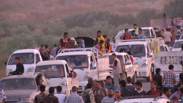 Members of the Yazidi community arriving in Irbil in northern Iraq after Islamic militants attacked the towns of Sinjar and Zunmar