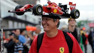 A Ferrari fan sports a novelty hat
