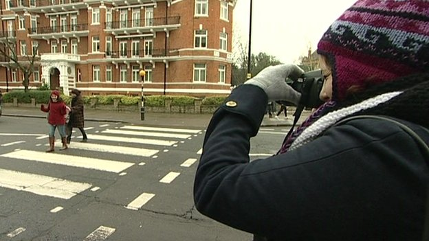 People taking photos on the Abbey Road crossing