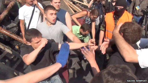 Scuffles at a protest site in Kiev, 9 August (photo: Rachel Newport)