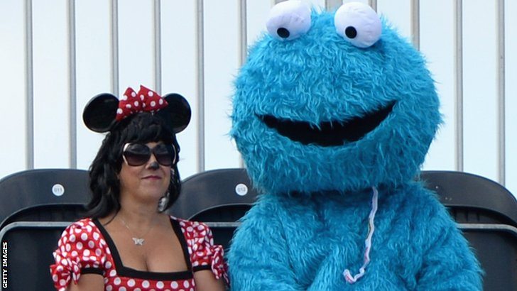 Fans dressed as Minnie Mouse and Cookie Monster