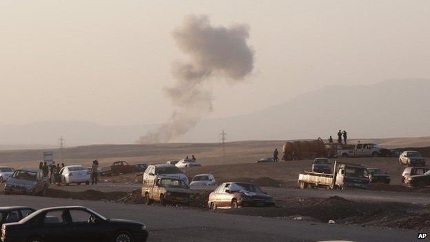 Smoke rises from the scene of a US air strike in northern Iraq (8 August 2014)