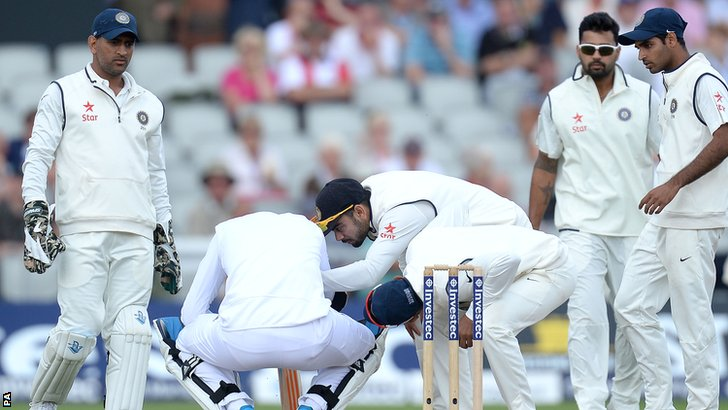 India's fielders surround England's Stuart Broad