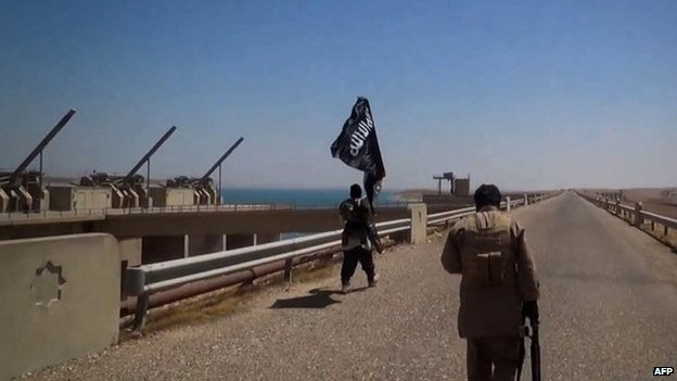 Photo published online purportedly showing Islamic State (IS) fighters patrolling the Mosul dam (9 August 2014)