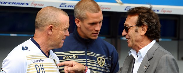 Leeds chairman Massimo Cellino (right) talks to manager Dave Hockaday