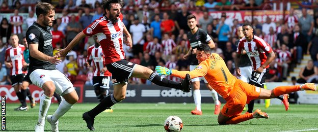 Brentford's Jonathan Douglas goes close.