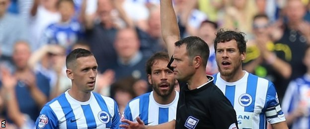 "Referee James Linington sends off Brighton""s Andrew Crofts"