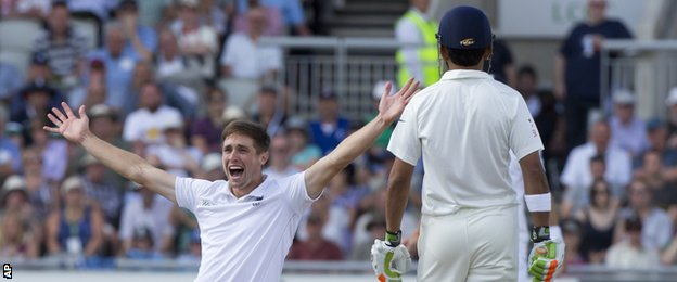 England's Chris Woakes celebrates a wicket