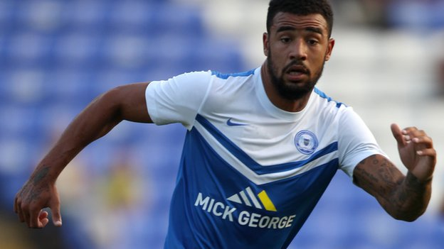 Peterborough see off League One newcomers Rochdale to make a winning start to the campaign thanks to Kyle Vassell's second-half goal.