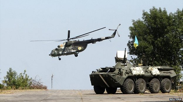 A Ukrainian helicopter and armoured vehicle near Donetsk, 9 August