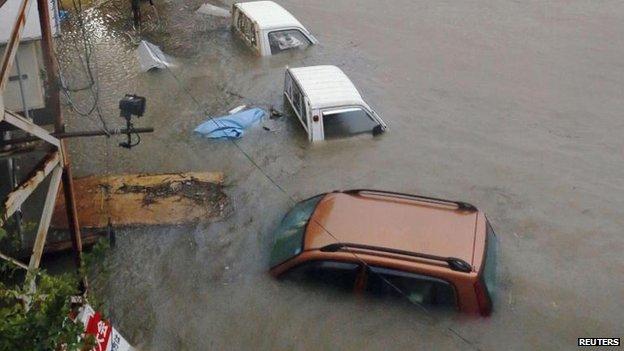 Stranded cars in Kochi, western Japan, 10 Aug