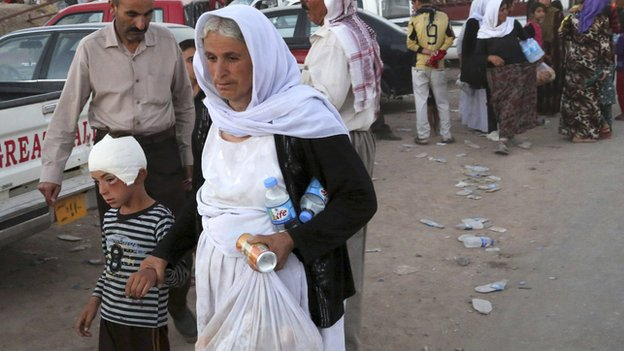 Displaced people from Yazidi community arrive at Bajid Kandala camp on 9  August