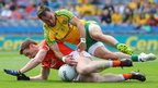 Armagh's Charlie Vernon and Karl Lacey of Donegal hit the deck in a battle for possession during the All-Ireland last-eight contest