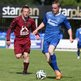 Thomas McBride of Institute closes in on Dungannon's Andrew Burns at Stangmore Park