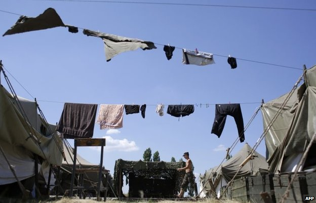 A serviceman walks in the camp of the Ukrainian troops in Donetsk region on August 9
