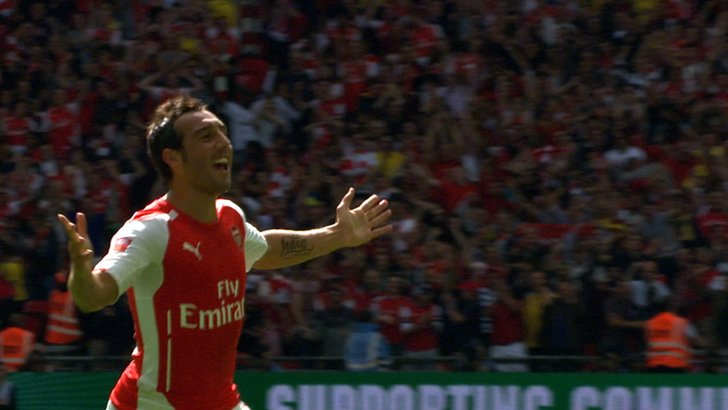 Santi Cazorla celebrates scoring at Wembley