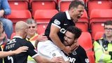 Dundee United's Ryan Dow (right) celebrates his goal with team-mates as they take the lead against Aberdeen
