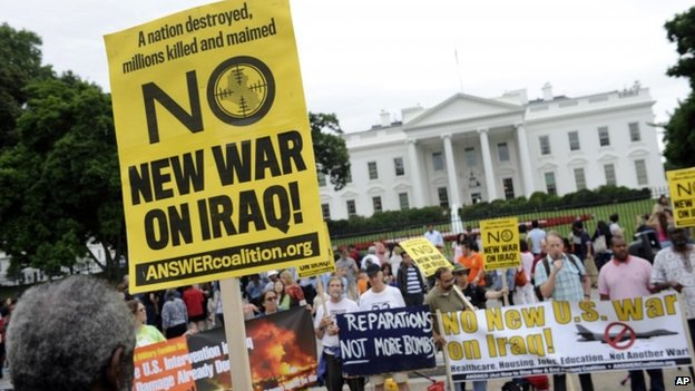 This photo taken Saturday, June 21, 2014, shows demonstrators protesting outside of the White House in Washington against renewed U.S. involvement in Iraq