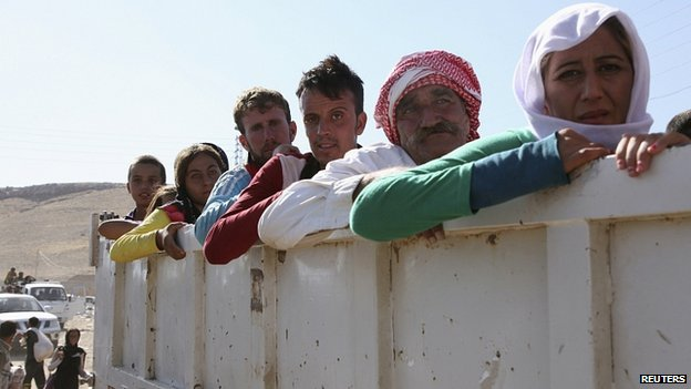 Displaced people from Yazidi sect re-enter Iraq from Syria at Iraqi-Syrian border crossing in Fishkhabour, Dohuk Province. 10 Aug 2014